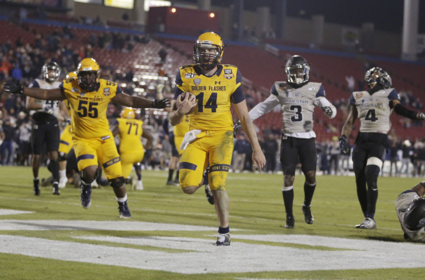 Dec 20, 2019; Frisco, TX, USA; Kent State Golden Flashes quarterback Dustin Crum (14) scores a touchdown in the fourth quarter against the Utah State Aggies during the Frisco Bowl at Toyota Stadium. Mandatory Credit: Tim Heitman-USA TODAY Sports