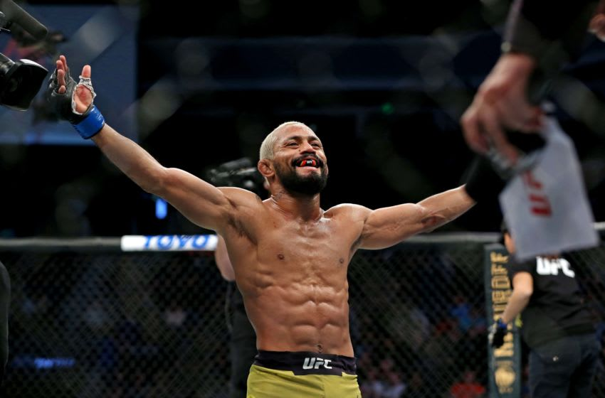 Feb 29, 2020; Norfolk, Virginia, USA; Deiveson Figueiredo (blue gloves) celebrates beating Joseph Benavidez (red gloves) during UFC Fight Night at Chartway Arena. Mandatory Credit: Peter Casey-USA TODAY Sports