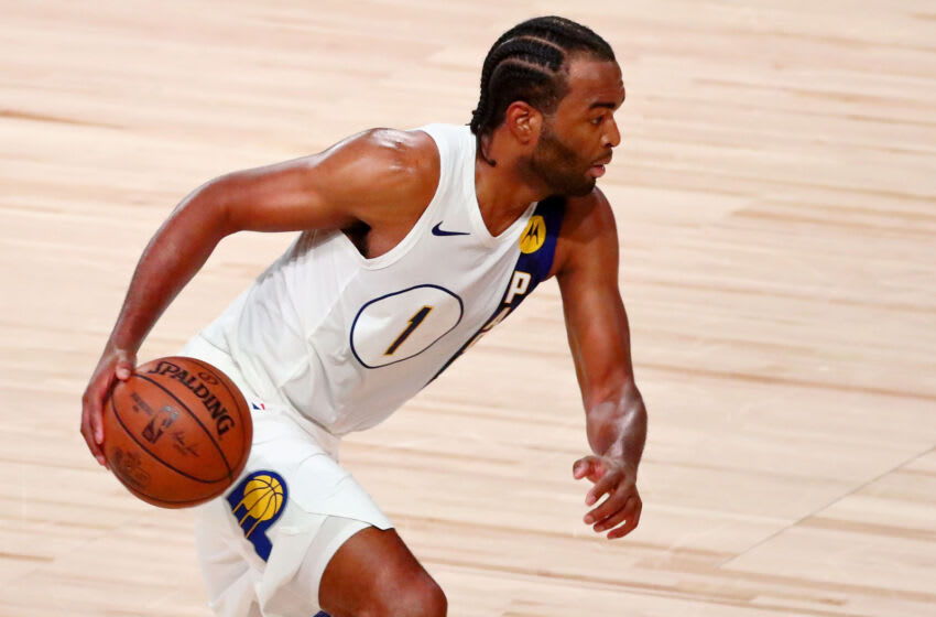 Aug 22, 2020; Lake Buena Vista, Florida, USA; Indiana Pacers forward T.J. Warren (1) dribbles against the Miami Heat during the second half of Game 3 of an NBA basketball first-round playoff series at AdventHealth Arena. Mandatory Credit: Kim Klement-USA TODAY Sports
