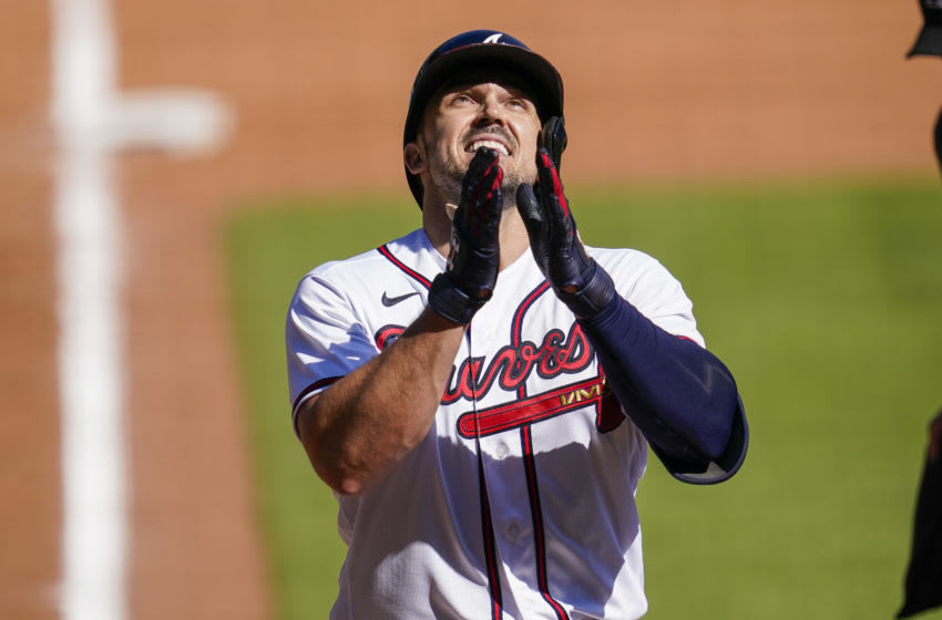 Sep 7, 2020; Cumberland, Georgia, USA; Atlanta Braves pinch hitter Adam Duvall (23) reacts after hitting a game tying home run against the Miami Marlins during the ninth inning at Truist Park. Mandatory Credit: Dale Zanine-USA TODAY Sports