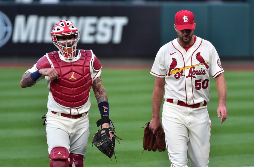 Sep 26, 2020; St. Louis, Missouri, USA; St. Louis Cardinals catcher Yadier Molina (4) walks in from the bullpen with starting pitcher Adam Wainwright (50) prior to a game against the Milwaukee Brewers at Busch Stadium. Mandatory Credit: Jeff Curry-USA TODAY Sports