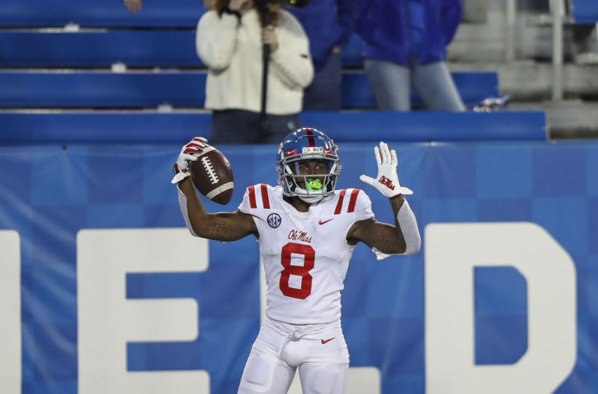 Oct 3, 2020; Lexington, Kentucky, USA; Mississippi Rebels wide receiver Elijah Moore (8) celebrates after a touchdown in overtime against Kentucky at Kroger Field. Mandatory Credit: Katie Stratman-USA TODAY Sports
