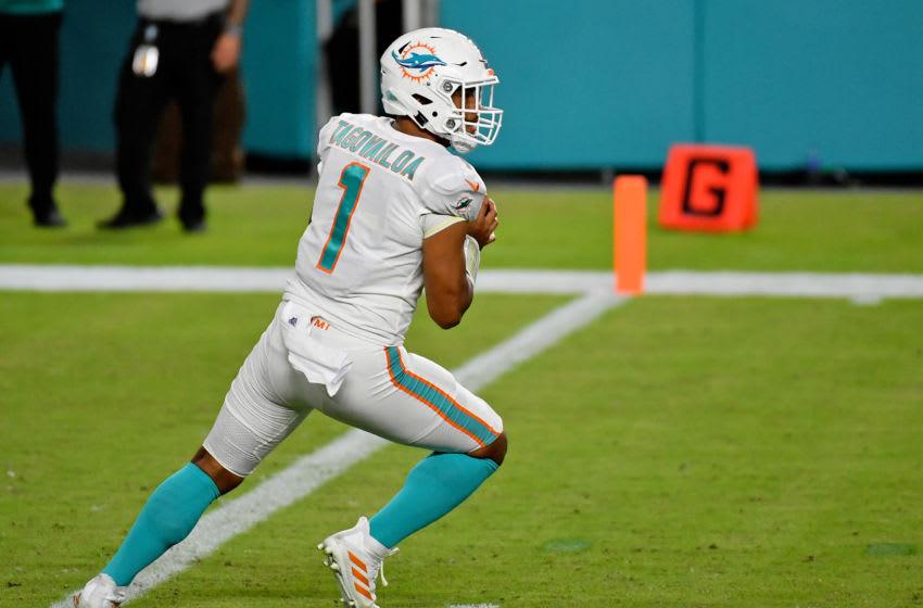 Oct 18, 2020; Miami Gardens, Florida, USA; Miami Dolphins quarterback Tua Tagovailoa (1) drops back during the second half against the New York Jets at Hard Rock Stadium. Mandatory Credit: Jasen Vinlove-USA TODAY Sports