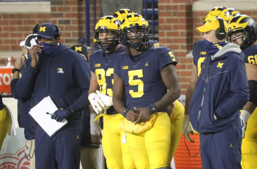 Michigan Wolverines quarterback Joe Milton (5) on the sidelines during action against the Wisconsin Badgers at Michigan Stadium in Ann Arbor, Nov. 14, 2020. Wolverines