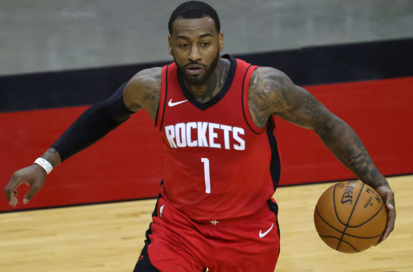 Jan 2, 2021; Houston, Texas, USA; John Wall #1 of the Houston Rockets controls the ball during the fourth quarter of a game against the Sacramento Kings at Toyota Center on January 02, 2021 in Houston, Texas. Mandatory Credit: Carmen Mandato/Pool Photo-USA TODAY Sports