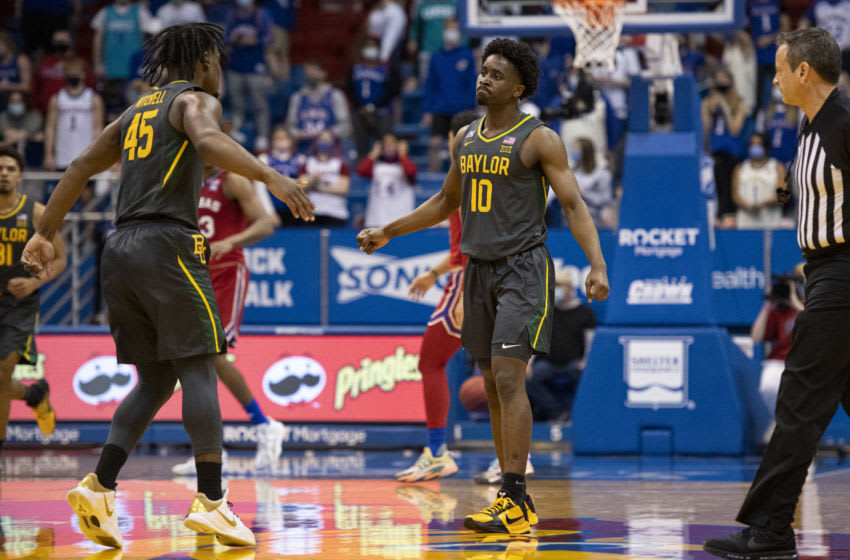 Feb 27, 2021; Lawrence, Kansas, USA; Baylor Bears guard Davion Mitchell (45) high fives Baylor Bears guard Adam Flagler (10) after a play against the Kansas Jayhawks in the first half at Allen Fieldhouse. Mandatory Credit: Amy Kontras-USA TODAY Sports