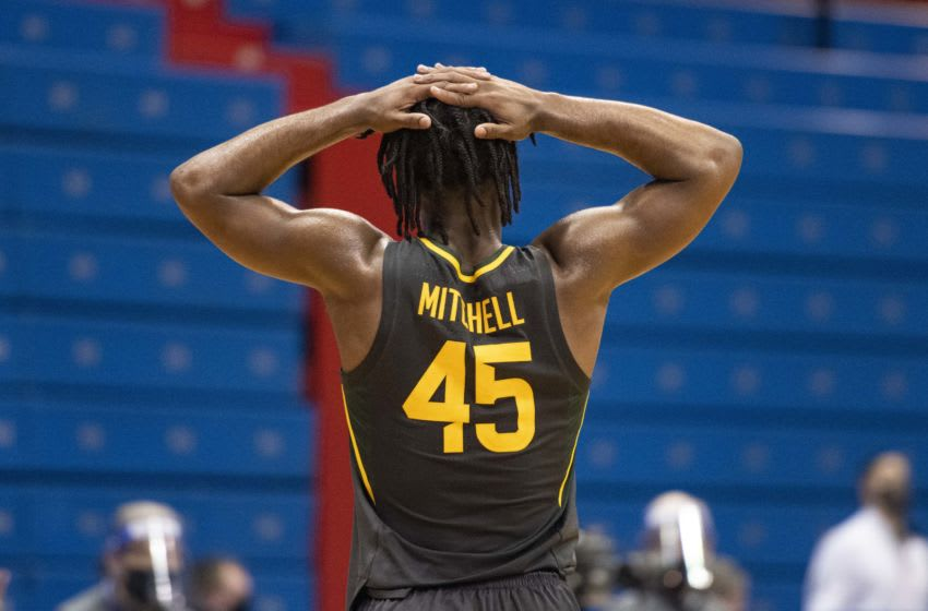 Feb 27, 2021; Lawrence, Kansas, USA; Baylor Bears guard Davion Mitchell (45) reacts after a foul against the Kansas Jayhawks in the second half at Allen Fieldhouse. Mandatory Credit: Amy Kontras-USA TODAY Sports