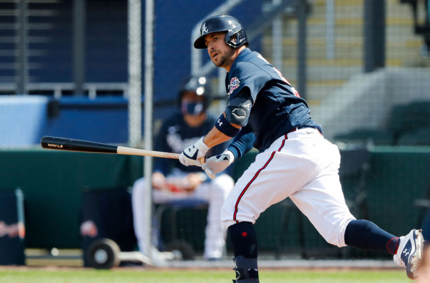 Mar 5, 2021; North Port, Florida, USA; Atlanta Braves third baseman Sean Kazmar Jr. (53) hits a two-RBI double in the bottom of the sixth inning against the Minnesota Twins during spring training at CoolToday Park. Mandatory Credit: Nathan Ray Seebeck-USA TODAY Sports