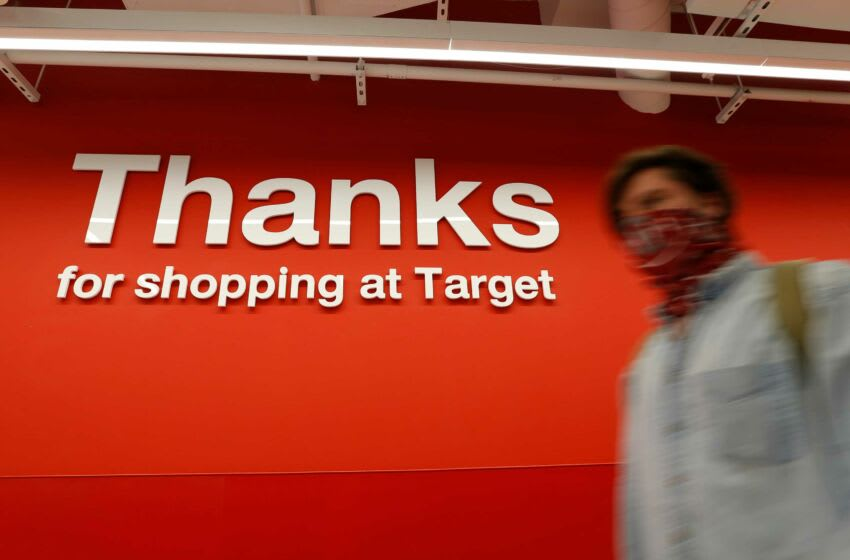 Shoppers head for the checkout during a soft opening of the new downtown Target store in Athens, Ga., on Tuesday, April 13, 2021. News Joshua L Jones