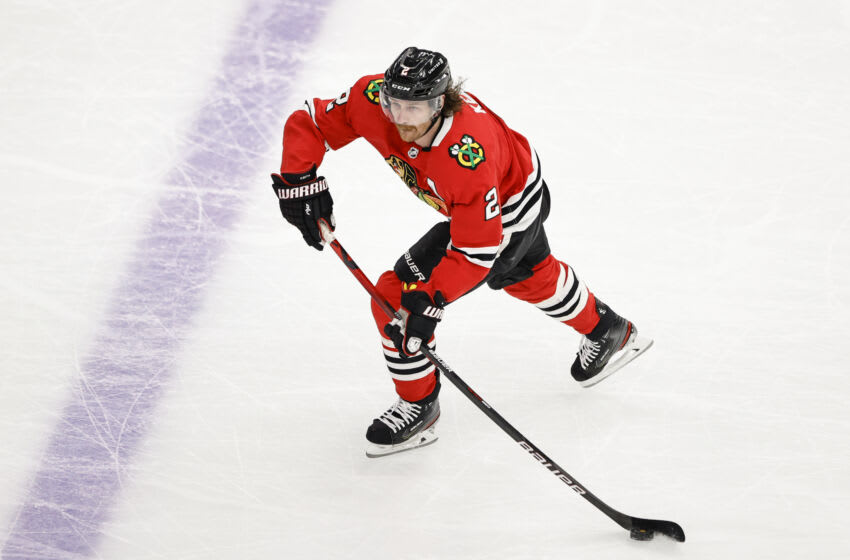 Apr 23, 2021; Chicago, Illinois, USA; Chicago Blackhawks defenseman Duncan Keith (2) looks to pass the puck against the Nashville Predators during the first period at United Center. Mandatory Credit: Kamil Krzaczynski-USA TODAY Sports