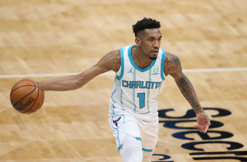 May 9, 2021; Charlotte, North Carolina, USA; Charlotte Hornets guard Malik Monk (1) looks to pass against the New Orleans Pelicans in the second half at Spectrum Center. The New Orleans Pelicans won 112-110. Mandatory Credit: Nell Redmond-USA TODAY Sports
