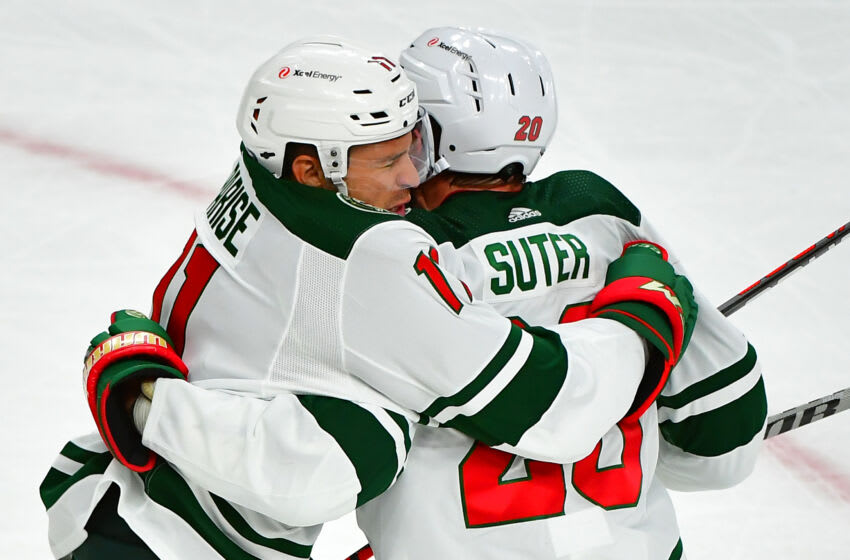 May 28, 2021; Las Vegas, Nevada, USA;Minnesota Wild left wing Zach Parise (11) celebrates with Minnesota Wild defenseman Ryan Suter (20) after scoring a first period goal against the Vegas Golden Knights in game seven of the first round of the 2021 Stanley Cup Playoffs at T-Mobile Arena. Mandatory Credit: Stephen R. Sylvanie-USA TODAY Sports
