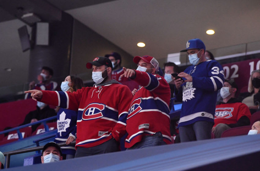 May 29, 2021; Montreal, Quebec, CAN; Fans cheer during the warmup period before game six between the Toronto Maple Leafs and the Montreal Canadiens in the first round of the 2021 Stanley Cup Playoffs at the Bell Centre. This is the first game in Canada with a limited attendance allowed since the Covid 19 pandemic. Mandatory Credit: Eric Bolte-USA TODAY Sports