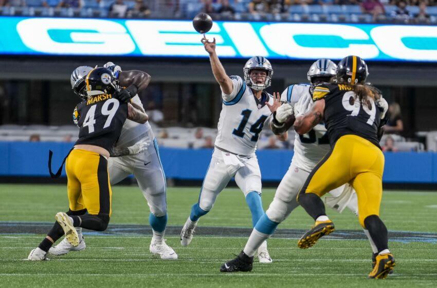 Aug 27, 2021; Charlotte, North Carolina, USA; Carolina Panthers quarterback Sam Darnold (14) makes a throw against the Pittsburgh Steelers during the first quarter at Bank of America Stadium. Mandatory Credit: Jim Dedmon-USA TODAY Sports