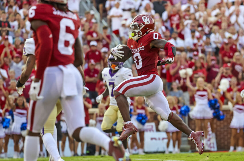 Sep 11, 2021; Norman, Oklahoma, USA; Oklahoma Sooners running back Eric Gray (0) runs for a touchdown during the first quarter against the Western Carolina Catamounts at Gaylord Family-Oklahoma Memorial Stadium. Mandatory Credit: Kevin Jairaj-USA TODAY Sports