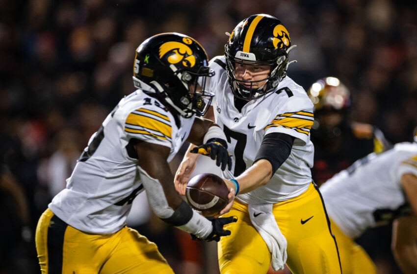 Oct 1, 2021; College Park, Maryland, USA; Iowa Hawkeyes quarterback Spencer Petras (7) hands the ball off to running back Tyler Goodson (15) during the second half of the game against the Maryland Terrapins at Capital One Field at Maryland Stadium. Mandatory Credit: Scott Taetsch-USA TODAY Sports