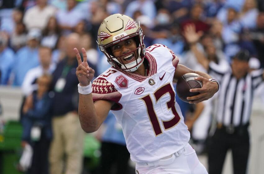 Oct 9, 2021; Chapel Hill, North Carolina, USA; Florida State Seminoles quarterback Jordan Travis (13) runs for a touchdown against the North Carolina Tar Heels during the first half at Kenan Memorial Stadium. Mandatory Credit: James Guillory-USA TODAY Sports