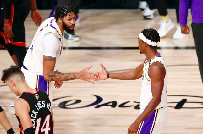 Oct 11, 2020; Lake Buena Vista, Florida, USA; Los Angeles Lakers guard Rajon Rondo (right) is congratulated by forward Anthony Davis (left) after scoring against the Miami Heat during the second quarter in game six of the 2020 NBA Finals at AdventHealth Arena. Mandatory Credit: Kim Klement-USA TODAY Sports