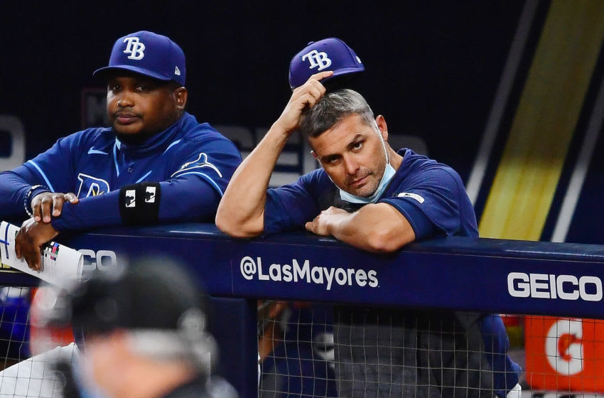 Oct 16, 2020; San Diego, California, USA; Tampa Bay Rays manager Kevin Cash (16) scratches his head after relief pitcher Jose Alvarado (not pictured) gave up two walks against the Houston Astros to start the eighth inning during game six of the 2020 ALCS at Petco Park. Mandatory Credit: Jayne Kamin-Oncea-USA TODAY Sports