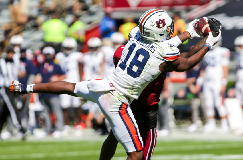 Auburn Tigers wide receiver Seth Williams (18) makes a catch over South Carolina Gamecocks defensive back Jaycee Horn (1) during the second quarter at Williams-Brice Stadium. Mandatory Credit: Jeff Blake-USA TODAY Sports