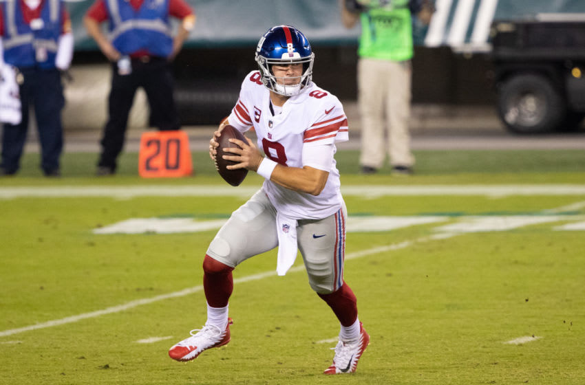 Oct 22, 2020; Philadelphia, Pennsylvania, USA; New York Giants quarterback Daniel Jones (8) rolls out to pass against the Philadelphia Eagles during the first quarter at Lincoln Financial Field. Mandatory Credit: Bill Streicher-USA TODAY Sports