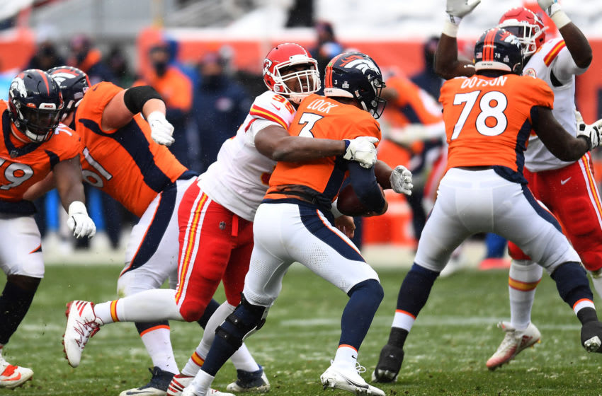 Oct 25, 2020; Denver, Colorado, USA; Kansas City Chiefs defensive tackle Chris Jones (95) sacks Denver Broncos quarterback Drew Lock (3) in the first half at Empower Field at Mile High. Mandatory Credit: Ron Chenoy-USA TODAY Sports