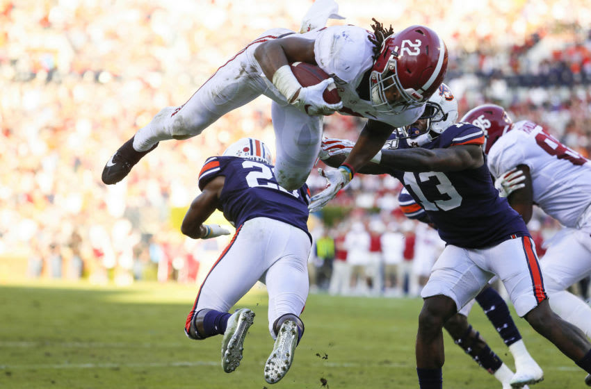 Alabama Crimson Tide running back Najee Harris (22) leaps over Auburn Tigers defensive back Roger McCreary (23) for a touchdown during the second quarter at Jordan-Hare Stadium. Mandatory Credit: John Reed-USA TODAY Sports