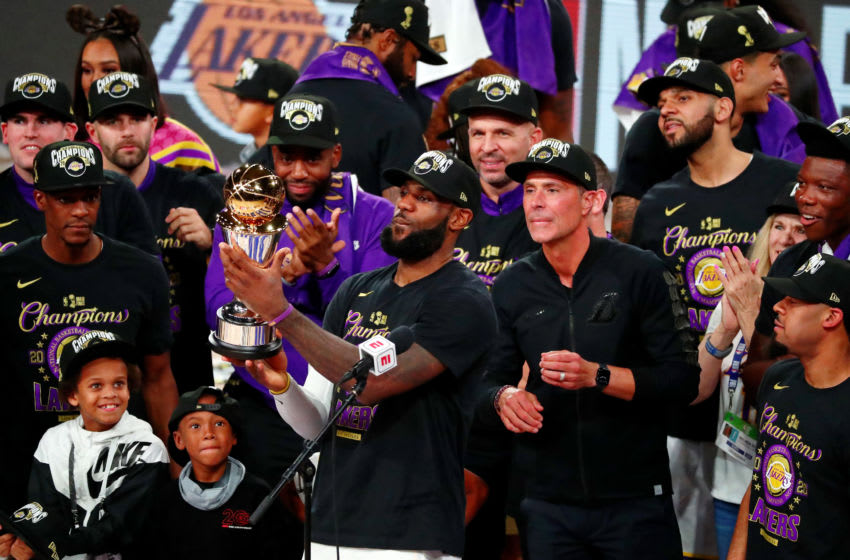 Oct 11, 2020; Lake Buena Vista, Florida, USA; Los Angeles Lakers forward LeBron James (23) holds up the MVP trophy after game six of the 2020 NBA Finals at AdventHealth Arena. The Los Angeles Lakers won 106-93 to win the series. Mandatory Credit: Kim Klement-USA TODAY Sports