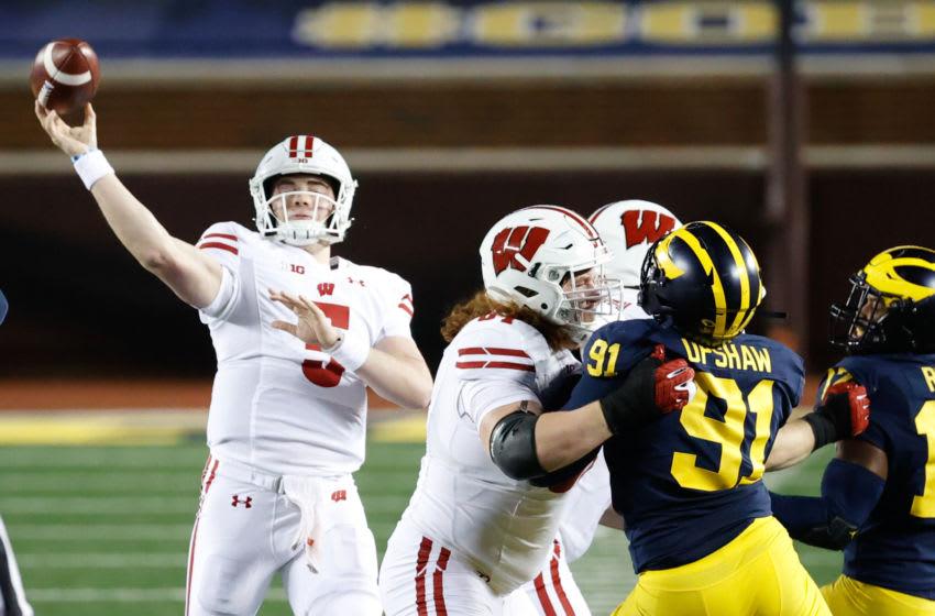 Wisconsin Badgers quarterback Graham Mertz (5) passes in the first half against the Michigan Wolverines at Michigan Stadium. Mandatory Credit: Rick Osentoski-USA TODAY Sports