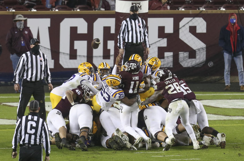 Nov 28, 2020; College Station, Texas, USA; Texas A&M Aggies quarterback Kellen Mond (11) fumbles the ball on the goal line against the LSU Tigers in the second quarter at Kyle Field. Mandatory Credit: Thomas Shea-USA TODAY Sports