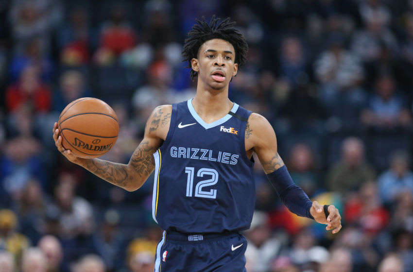 Mar 7, 2020; Memphis, Tennessee, USA; Memphis Grizzlies guard Ja Morant (12) dribbles against the Atlanta Hawks during a game at FedExForum. Memphis won 118-101. Mandatory Credit: Nelson Chenault-USA TODAY Sports