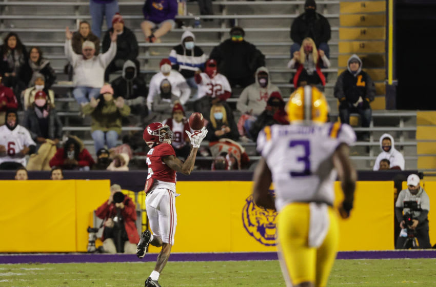 Dec 5, 2020; Baton Rouge, Louisiana, USA; Alabama Crimson Tide wide receiver DeVonta Smith (6) catches a touchdown against the LSU Tigers during the second quarter at Tiger Stadium. Mandatory Credit: Derick E. Hingle-USA TODAY Sports
