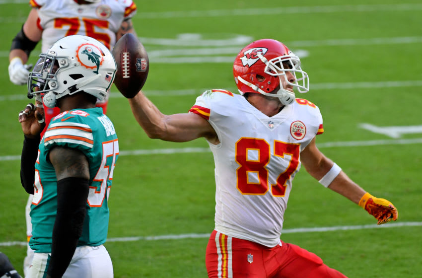 Dec 13, 2020; Miami Gardens, Florida, USA; Kansas City Chiefs tight end Travis Kelce (87) spikes the ball after scoring a touchdown against the Miami Dolphins during the first half at Hard Rock Stadium. Mandatory Credit: Jasen Vinlove-USA TODAY Sports