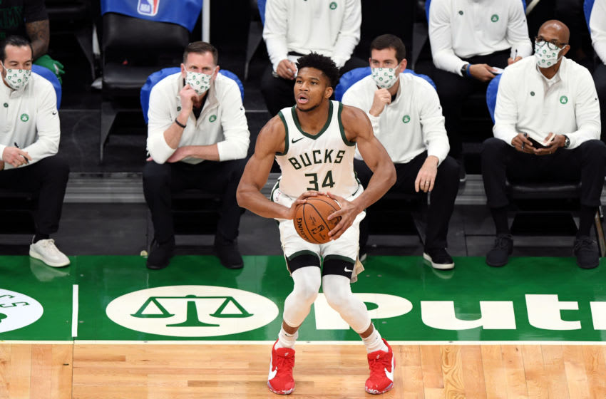 Dec 23, 2020; Boston, Massachusetts, USA; Milwaukee Bucks forward Giannis Antetokounmpo (34) attempts a free throw against the Boston Celtics during the first half at the TD Garden. Mandatory Credit: Brian Fluharty-USA TODAY Sports