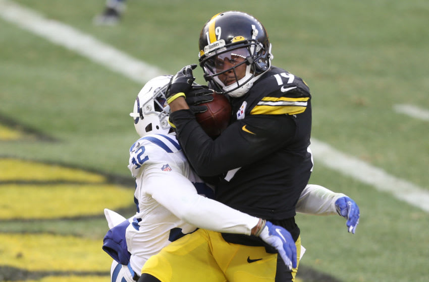 Dec 27, 2020; Pittsburgh, Pennsylvania, USA; Pittsburgh Steelers wide receiver JuJu Smith-Schuster (19) catches the game winning touchdown against Indianapolis Colts free safety Julian Blackmon (32) during the fourth quarter at Heinz Field. Mandatory Credit: Charles LeClaire-USA TODAY Sports