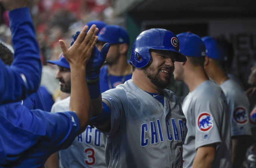 Sep 28, 2019; St. Louis, MO, USA; Chicago Cubs left fielder Kyle Schwarber (12) is congratulated by teammates after hitting a solo home run against the St. Louis Cardinals during the first inning at Busch Stadium. Mandatory Credit: Joe Puetz-USA TODAY Sports