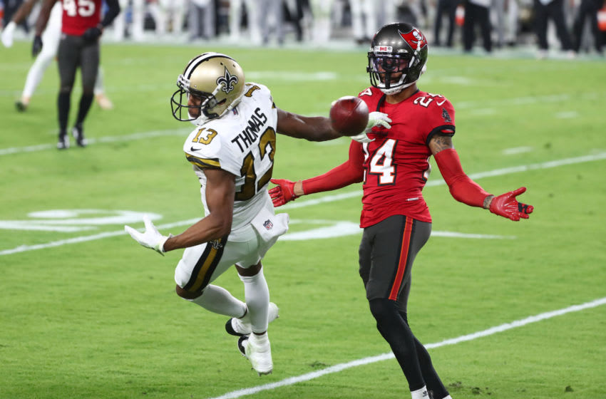 Nov 8, 2020; Tampa, Florida, USA; Tampa Bay Buccaneers cornerback Carlton Davis (24) defends New Orleans Saints wide receiver Michael Thomas (13) during the first half at Raymond James Stadium. Mandatory Credit: Kim Klement-USA TODAY Sports