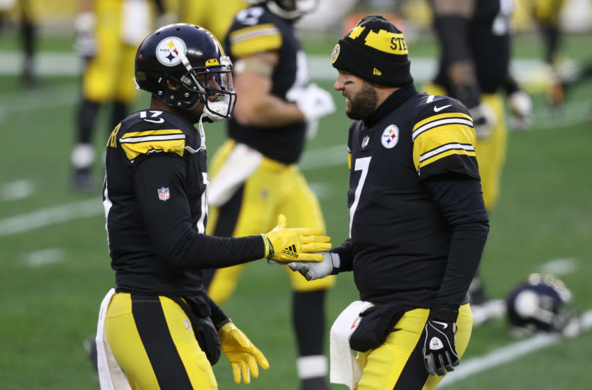 Dec 7, 2020; Pittsburgh, Pennsylvania, USA; Pittsburgh Steelers wide receiver JuJu Smith-Schuster (19) and quarterback Ben Roethlisberger (7) shake hands before playing the Washington Football Team at Heinz Field. Mandatory Credit: Charles LeClaire-USA TODAY Sports