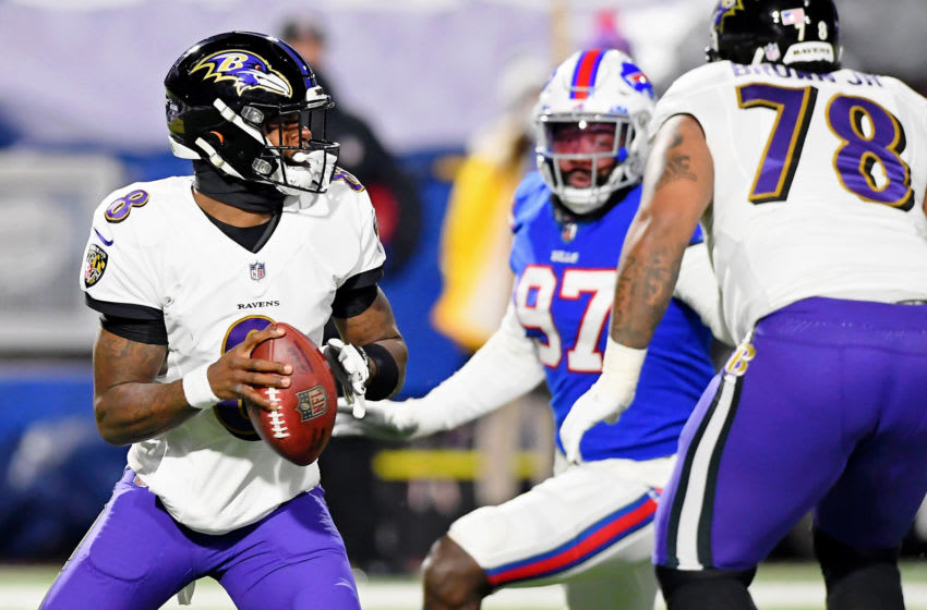 Jan 16, 2021; Orchard Park, New York, USA; Baltimore Ravens quarterback Lamar Jackson (8) looks to throw the ball against the Buffalo Bills during the first quarter of an AFC Divisional Round playoff game at Bills Stadium. Mandatory Credit: Rich Barnes-USA TODAY Sports