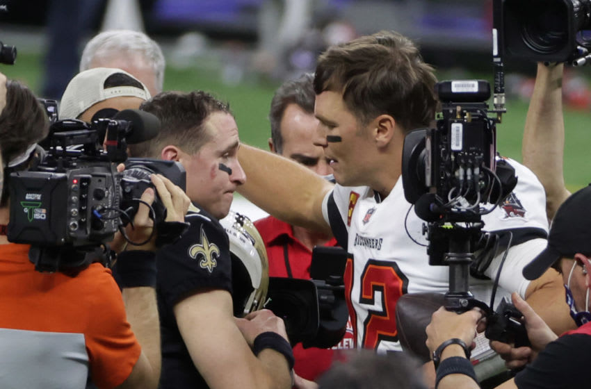 Jan 17, 2021; New Orleans, LA, USA; Tampa Bay Buccaneers quarterback Tom Brady (12) greets New Orleans Saints quarterback Drew Brees (9) after a NFC Divisional Round playoff game at Mercedes-Benz Superdome. Mandatory Credit: Derick E. Hingle-USA TODAY Sports