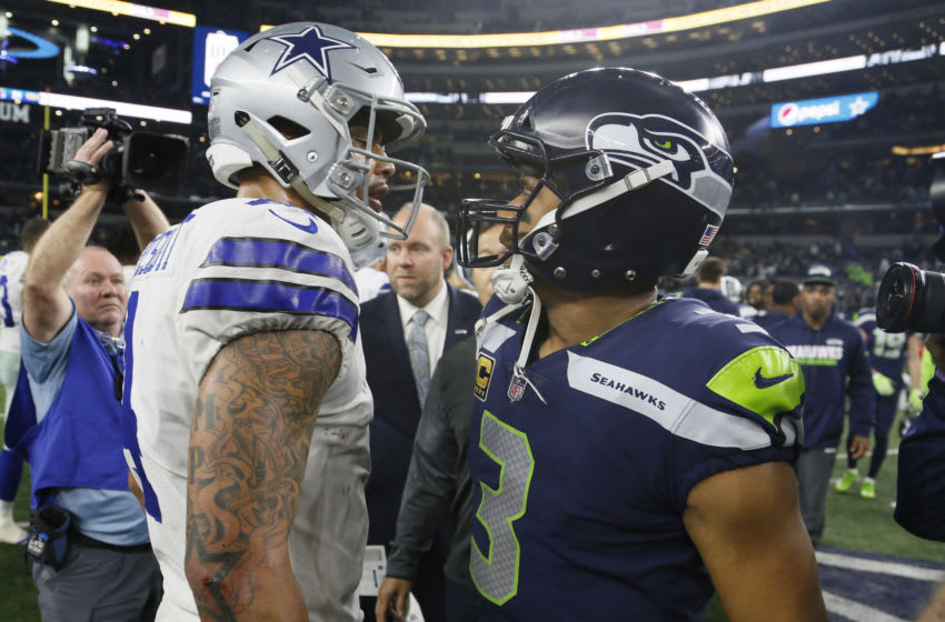 Dak Prescott of the Cowboys with Russell Wilson of the Seahawks. Mandatory Credit: Tim Heitman-USA TODAY Sports