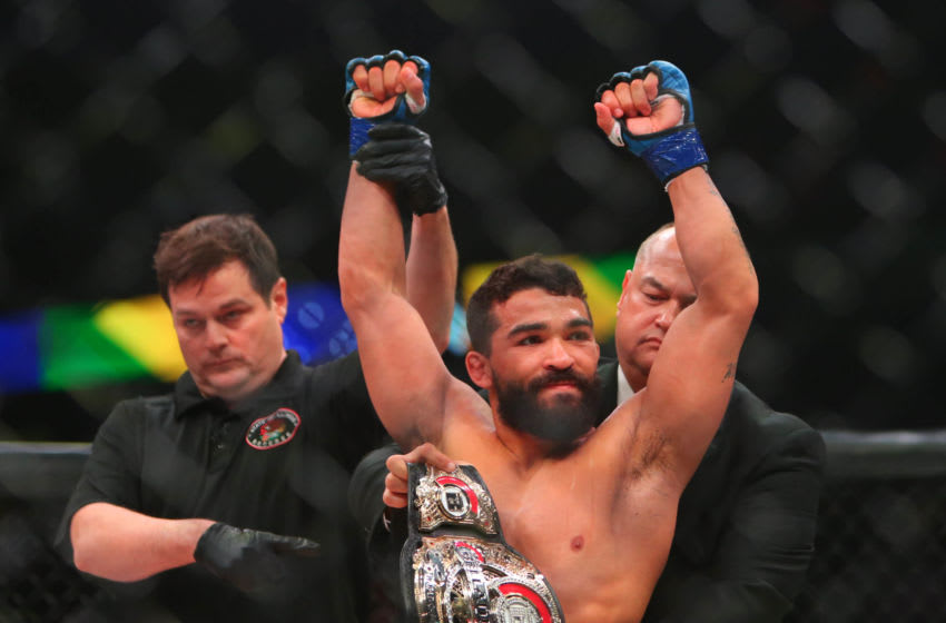 May 11, 2019; Rosemont, IL, USA; Patricio Freire (blue gloves) receives the championship belt after defeating Michael Chandler (red gloves) during Bellator 221 at Allstate Arena. Mandatory Credit: Jerry Lai-USA TODAY Sports