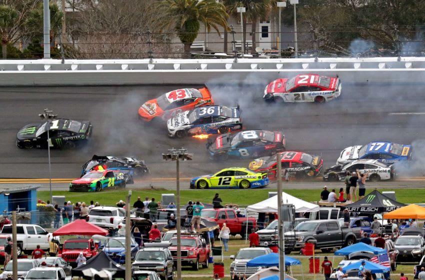 Feb 14, 2021; Daytona Beach, Florida, USA; NASCAR Cup Series drivers Ryan Newman (6), Erik Jones (43), William Byron (24) Tyler Reddick (8), Martin Truex Jr. (19), Aric Almirola (10) and Chris Buescher (17) wreck during the Daytona 500 at Daytona International Speedway. Mandatory Credit: Mark J. Rebilas-USA TODAY Sports