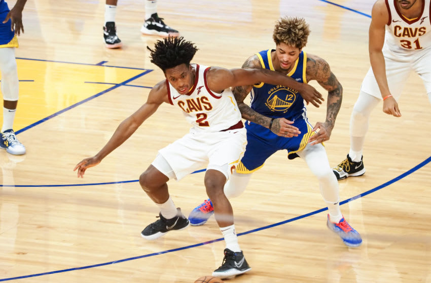 Feb 15, 2021; San Francisco, California, USA; Cleveland Cavaliers guard Collin Sexton (2) and Golden State Warriors forward-guard Kelly Oubre Jr. (12) chases down the ball during the first quarter at Chase Center. Mandatory Credit: Kelley L Cox-USA TODAY Sports