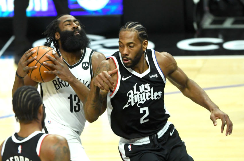Feb 21, 2021; Los Angeles, California, USA; Brooklyn Nets guard James Harden (13) is defended by Los Angeles Clippers forward Kawhi Leonard (2) as he drives to the basket in the first half of the game at Staples Center. Mandatory Credit: Jayne Kamin-Oncea-USA TODAY Sports
