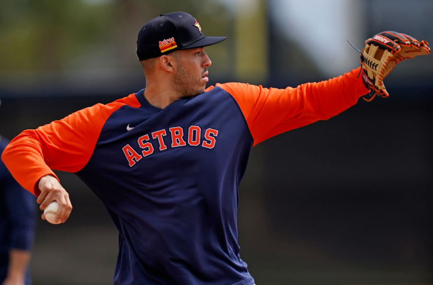 Feb 22, 2021; West Palm Beach, Florida, USA; Houston Astros shortstop Carlos Correa (1) takes infield practice during spring training workouts at The Ballpark of the Palm Beaches. Mandatory Credit: Jasen Vinlove-USA TODAY Sports