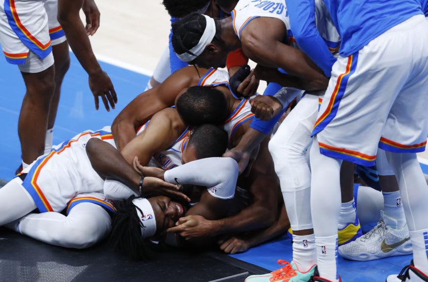 Oklahoma City Thunder celebrate with Lu Dort Mandatory Credit: Alonzo Adams-USA TODAY Sports
