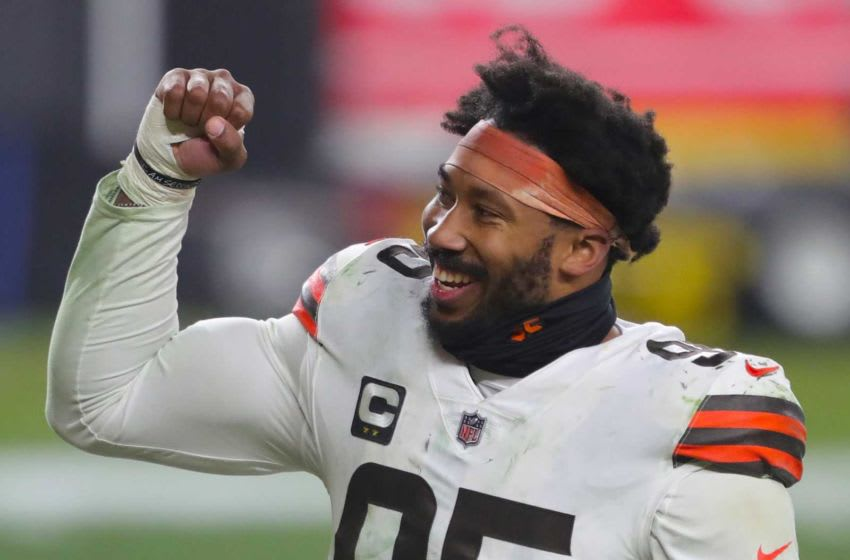 Cleveland Browns defensive end Myles Garrett (95) pumps his fist after beating the Pittsburgh Steelers in an NFL wild-card playoff football game, Sunday, Jan. 10, 2021, in Pittsburgh, Pennsylvania. [Jeff Lange/Beacon Journal] Browns Extras 9