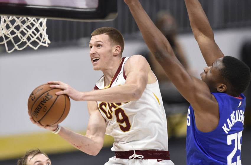 Feb 3, 2021; Cleveland, Ohio, USA; Cleveland Cavaliers guard Dylan Windler (9) goes up for a shot against LA Clippers forward Mfiondu Kabengele (25) in the fourth quarter at Rocket Mortgage FieldHouse. Mandatory Credit: David Richard-USA TODAY Sports