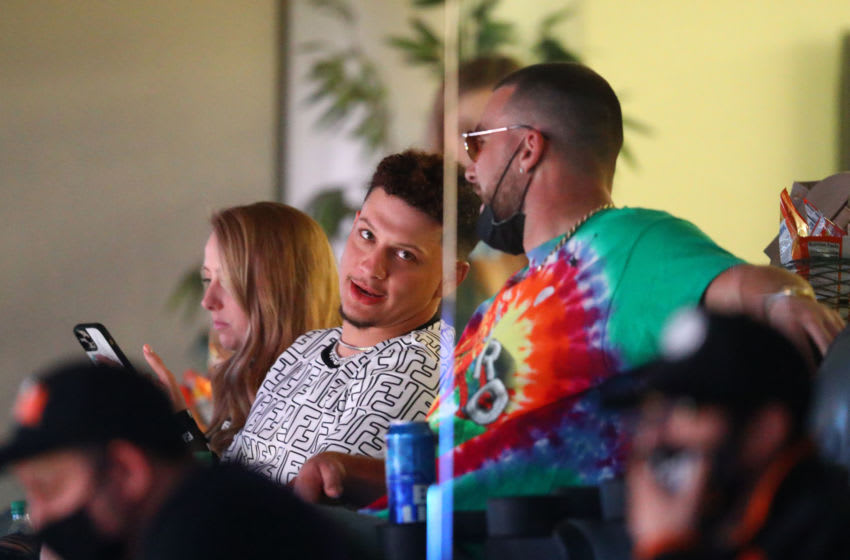 Kansas City Chiefs quarterback Patrick Mahomes (left) alongside teammate Travis Kelce in a suite during the Phoenix Suns game against the Los Angeles Lakers in the first half at Phoenix Suns Arena. Mandatory Credit: Mark J. Rebilas-USA TODAY Sports